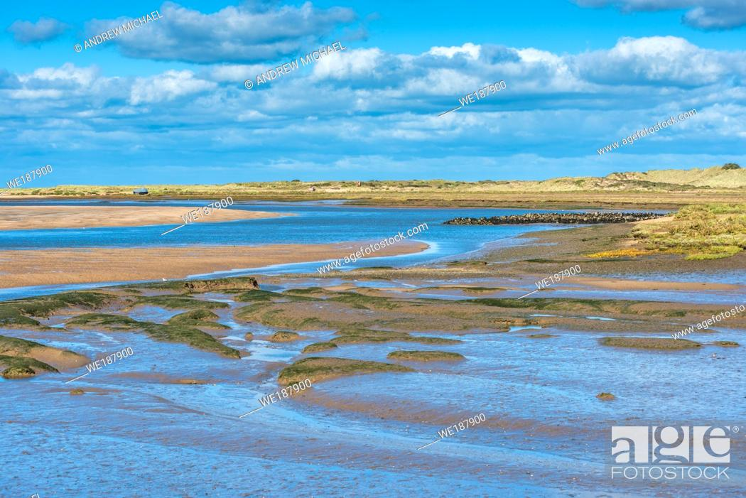 Stock Photo: Views of mudflats at low tide from Norfolk Coast path National Trail near Barnham Overy Staithe, Scolt Head Island to rear, East Anglia, England, UK.