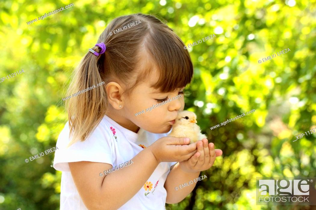 Stock Photo: Little girl with chick.