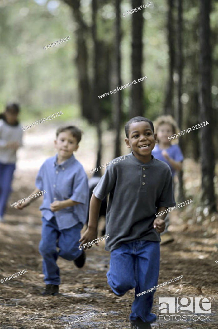 Stock Photo: Two boys and a girl running.