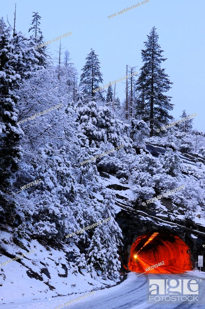 Stock Photo: Red Wawona Road tunnel and blue snow covered mountain at dawn in Yosemite National Park.