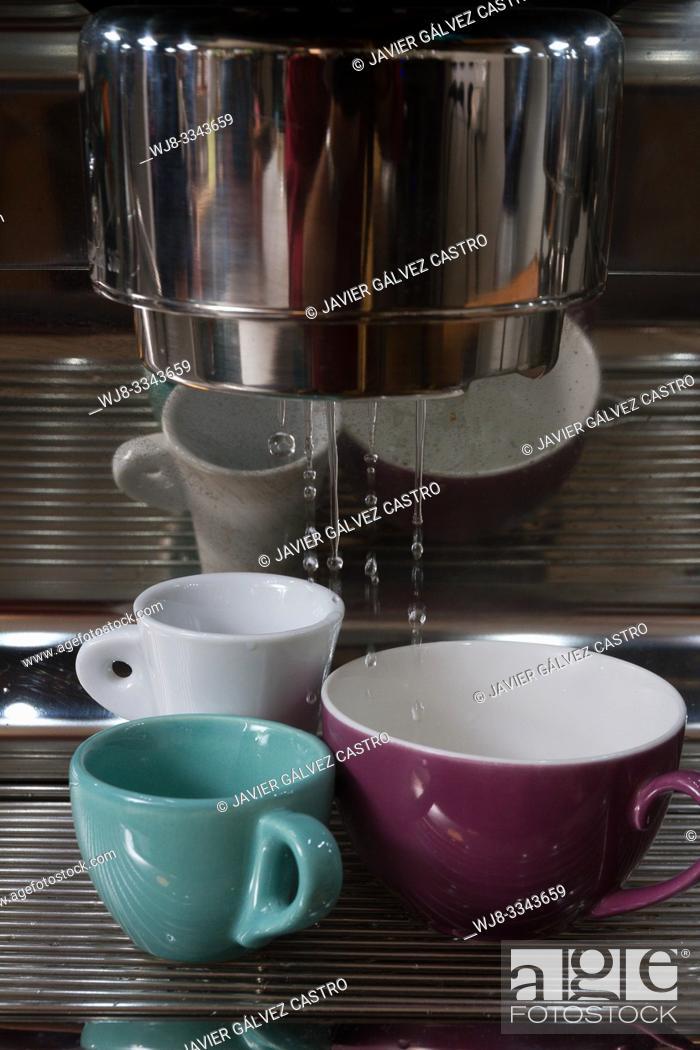 Stock Photo: Heating coffee cups in an Italian style machine.
