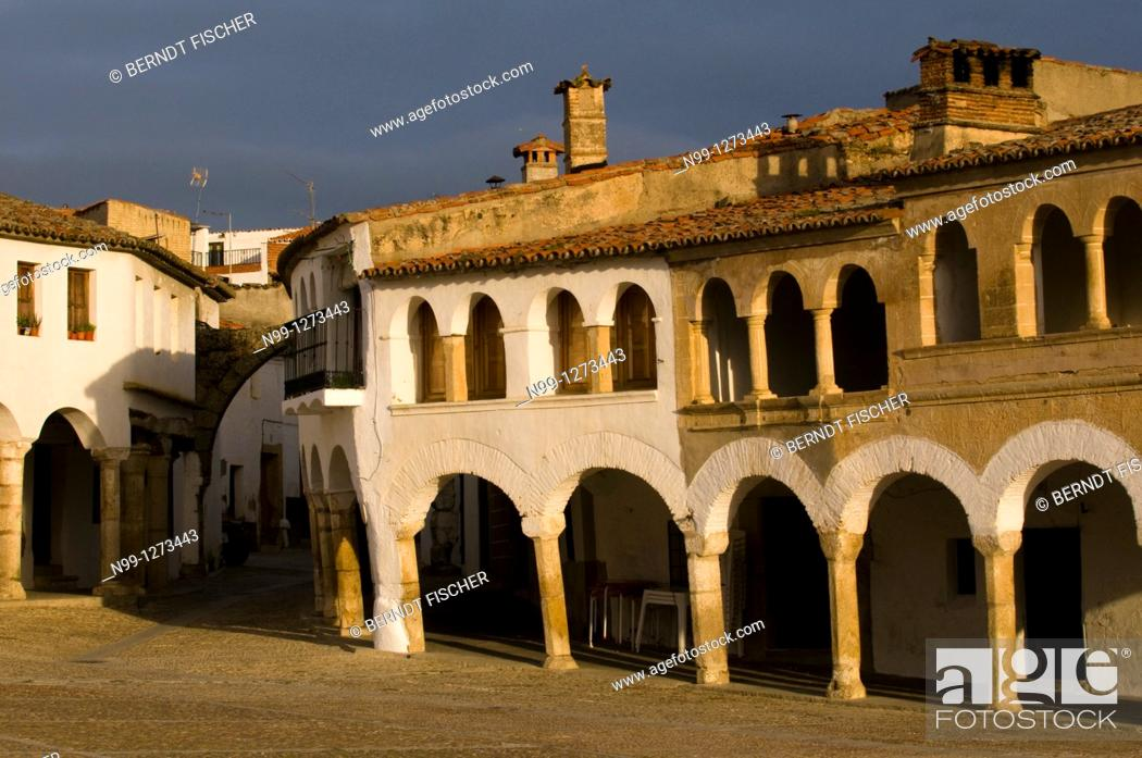 Stock Photo: Village of Garrovillas, Plaza Major, covered footpath and cobblestone pavement, Extremadura, Spain.