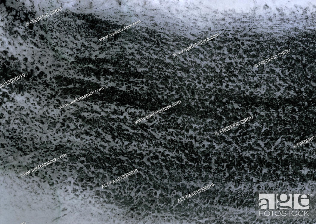 Stock Photo: Black charcoal on texture paper, close-up, full frame.