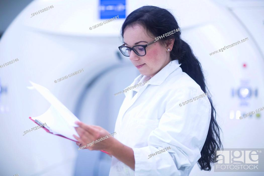 Stock Photo: Hospital radiologist checking notes.
