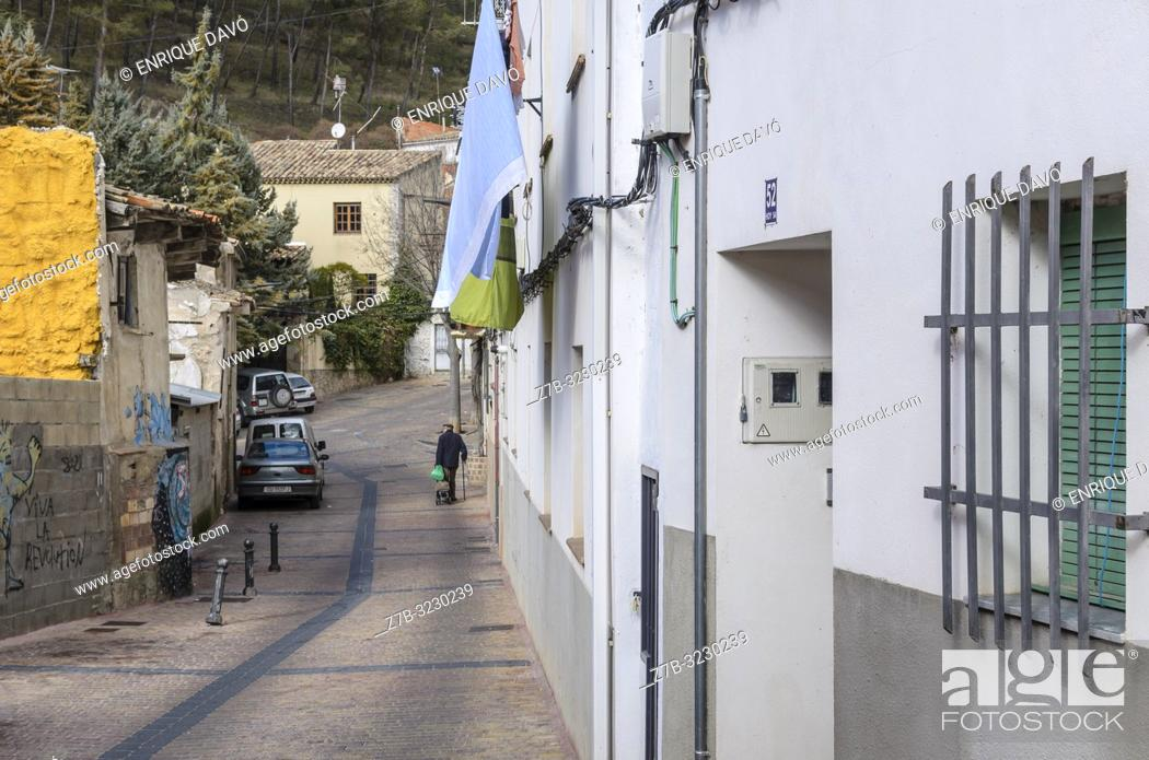 Stock Photo: Street scene with pedestrian in background, San Antón quarter, Cuenca, Castile-La Mancha, Spain.