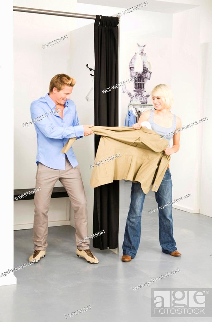 Stock Photo: Young couple in changing room.