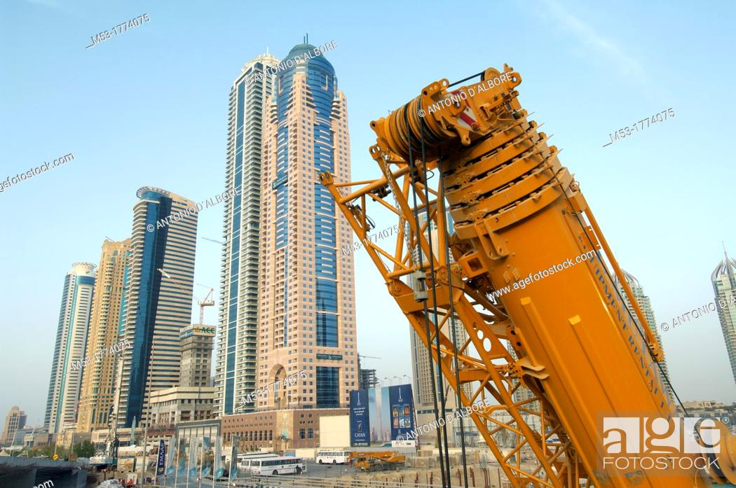 Stock Photo: a crane and new buildings in marina district  dubai  united arab emirates  middle east.