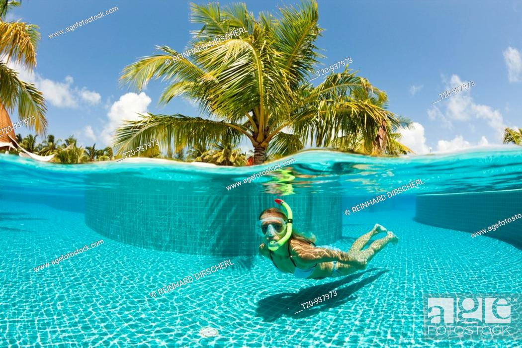 Stock Photo: Woman in Swimming Pool, South Male Atoll, Maldives.