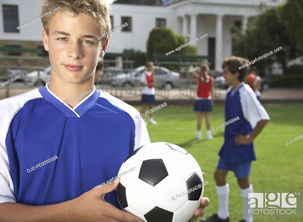 Stock Photo: Kids playing soccer.