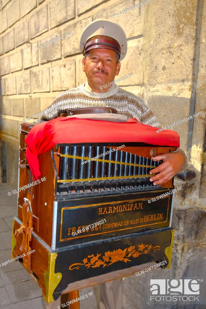Stock Photo: Portrait of a mature man holding a harmonipan, Mexico City, Mexico.