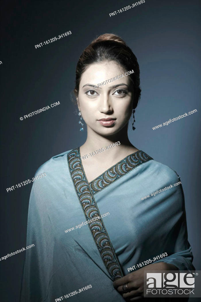Stock Photo: Portrait of a young woman wearing a sari.