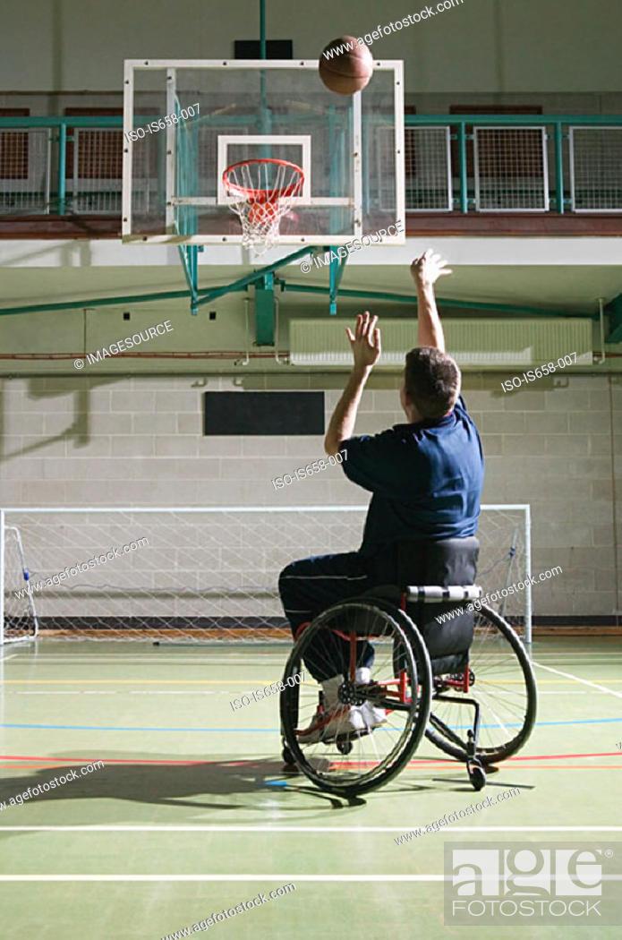 Stock Photo: Disabled man playing basketball.
