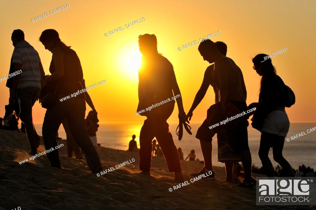 Stock Photo: Sunset. People. Dune of Pilat or Pyla (French: Dune du Pilat, official name), is the tallest sand dune in Europe. It is located in La Teste-de-Buch in the.
