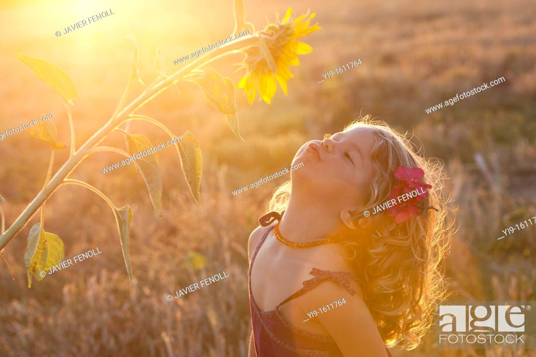 Stock Photo: portrait of a beautiful girl with a flower in her hair.