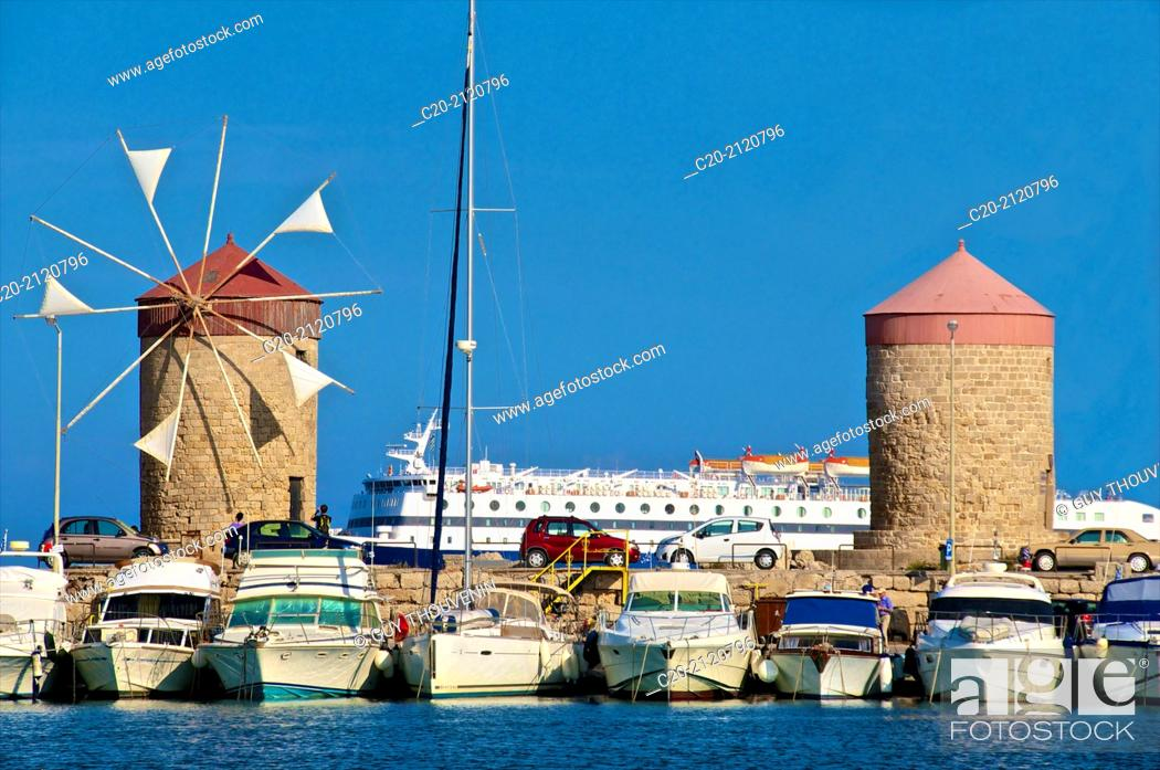Stock Photo: Windmills and tourists boats , in Mandraki harbor, Rhodes town , Rhodes island, Greece.