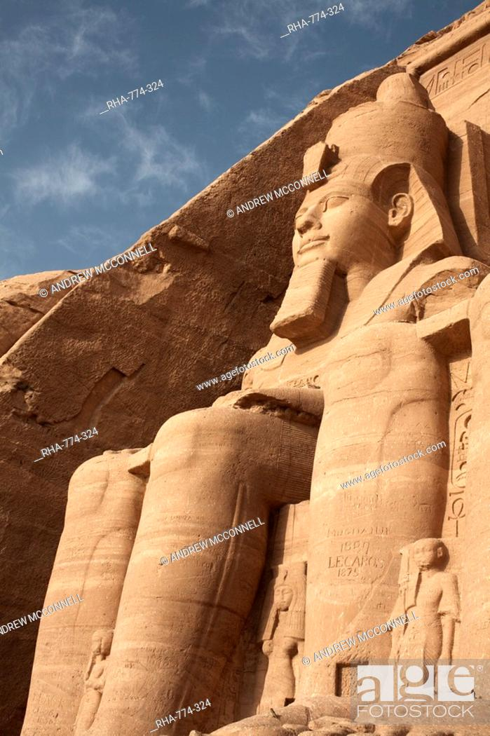 Stock Photo: A colossal statue of Ramses II sits at the entrance to the Great Temple of Abu Simbel, UNESCO World Heritage Site, Egypt, North Africa, Africa.