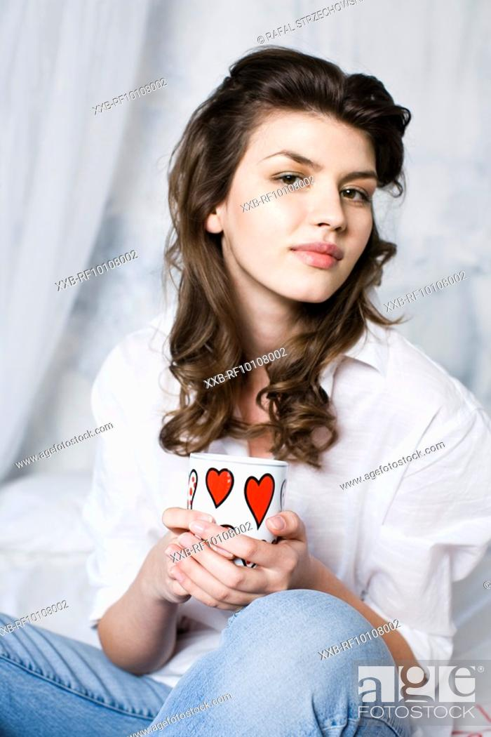 Stock Photo: Young woman drinking tea.
