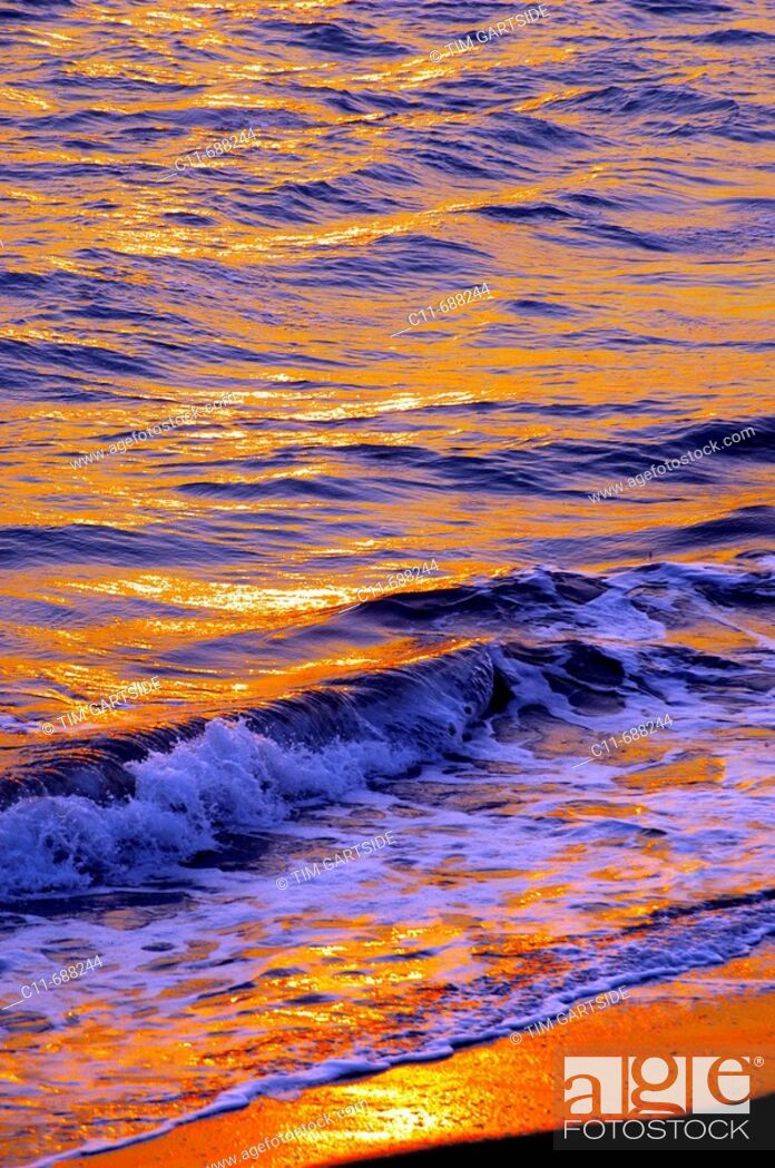 Stock Photo: Sunset reflected on sea waves, Florida, USA.