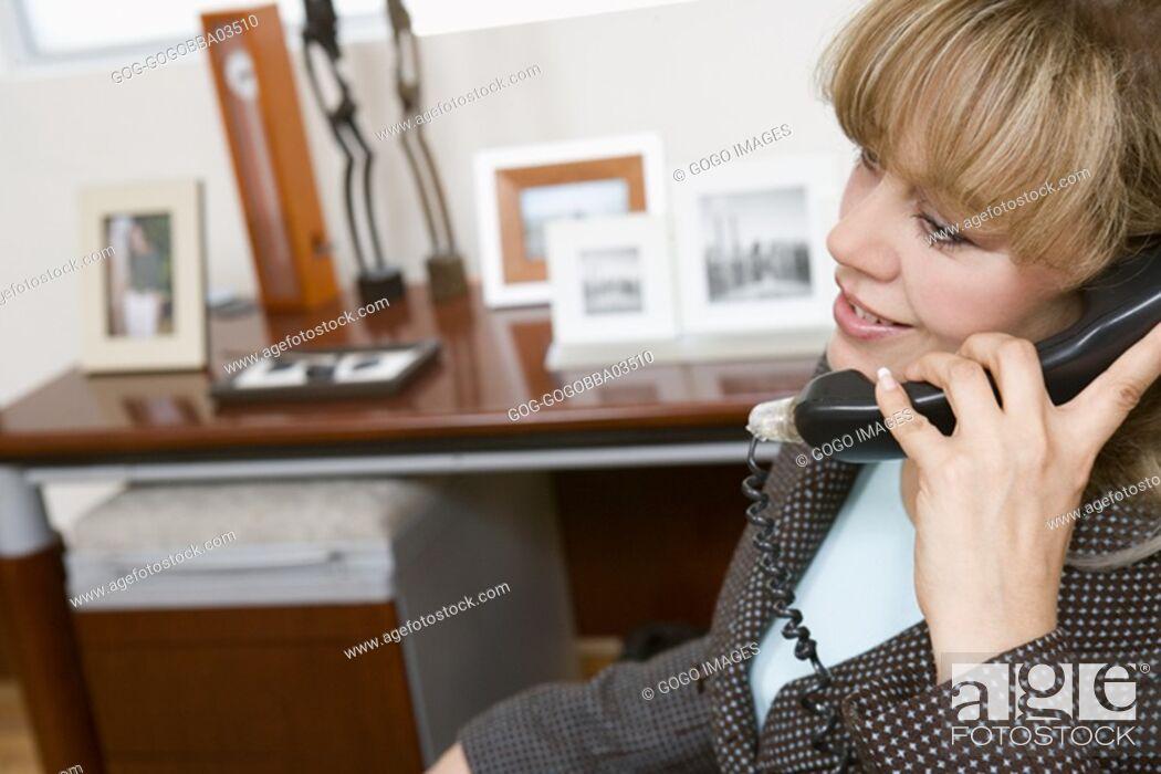 Stock Photo: Businesswoman talking on the phone.