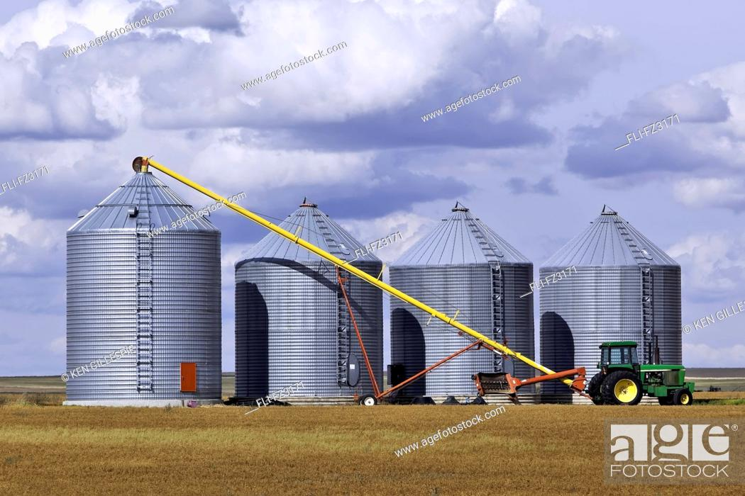 Stock Photo: Grain auger and tractor ready to fill silo, Assiniboia, Saskatchewan.