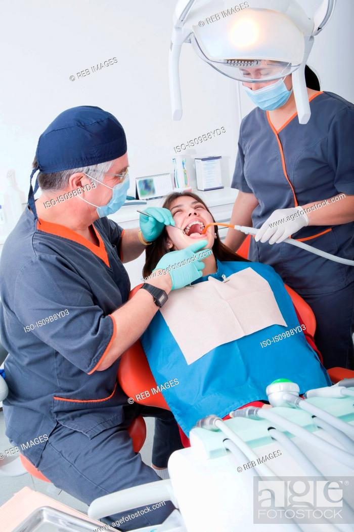 Stock Photo: Dentist and dental nurse with patient.