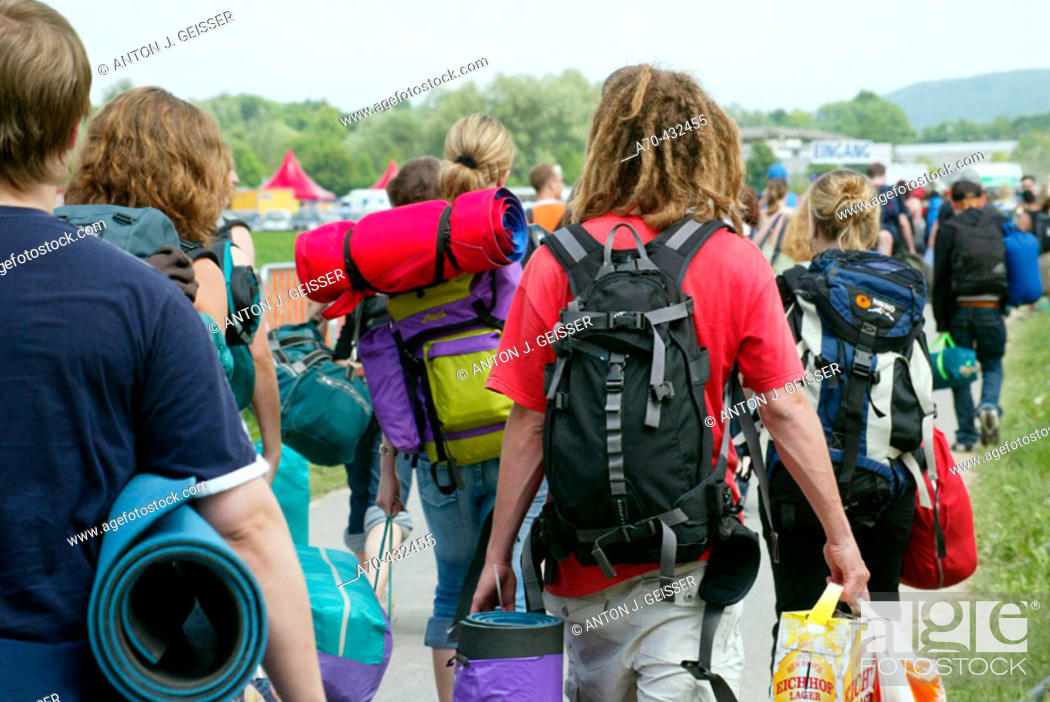 Stock Photo: Young people with backpacks, Openair Frauenfeld festival, Switzerland.