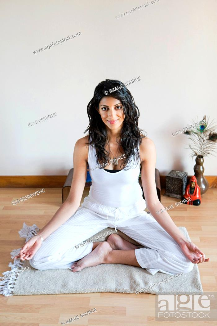 Stock Photo: Women in lotus position during yoga.