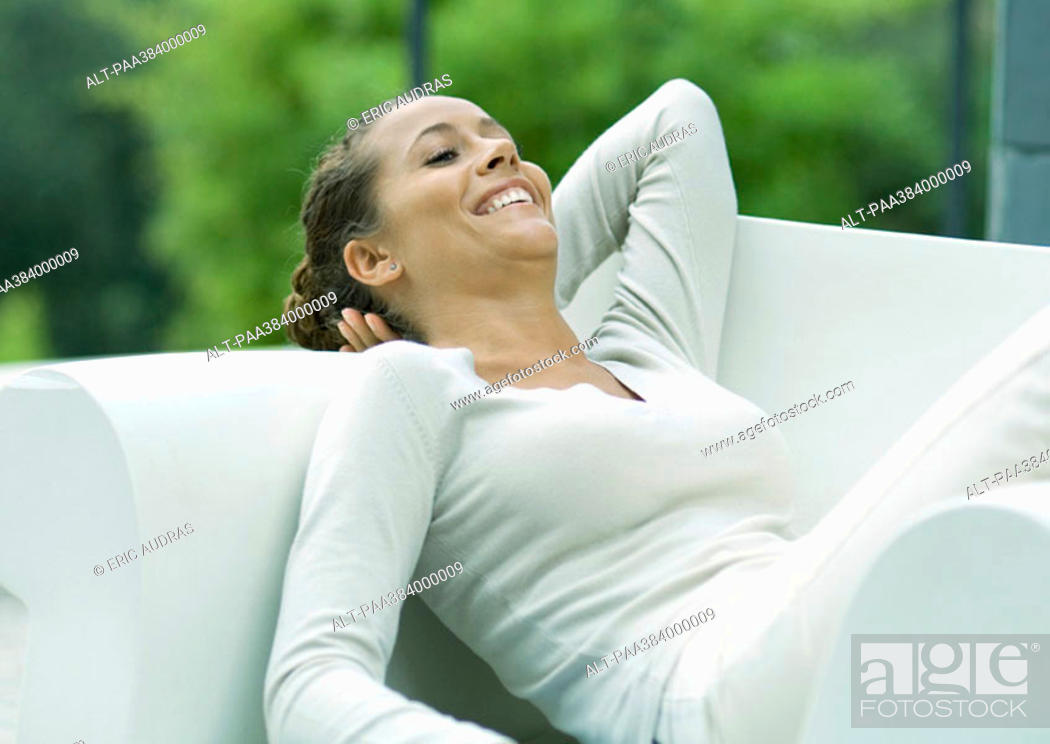 Stock Photo: Woman lounging in armchair.