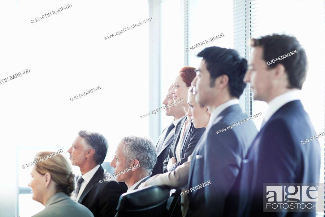 Stock Photo: Business people watching presentation in conference room.