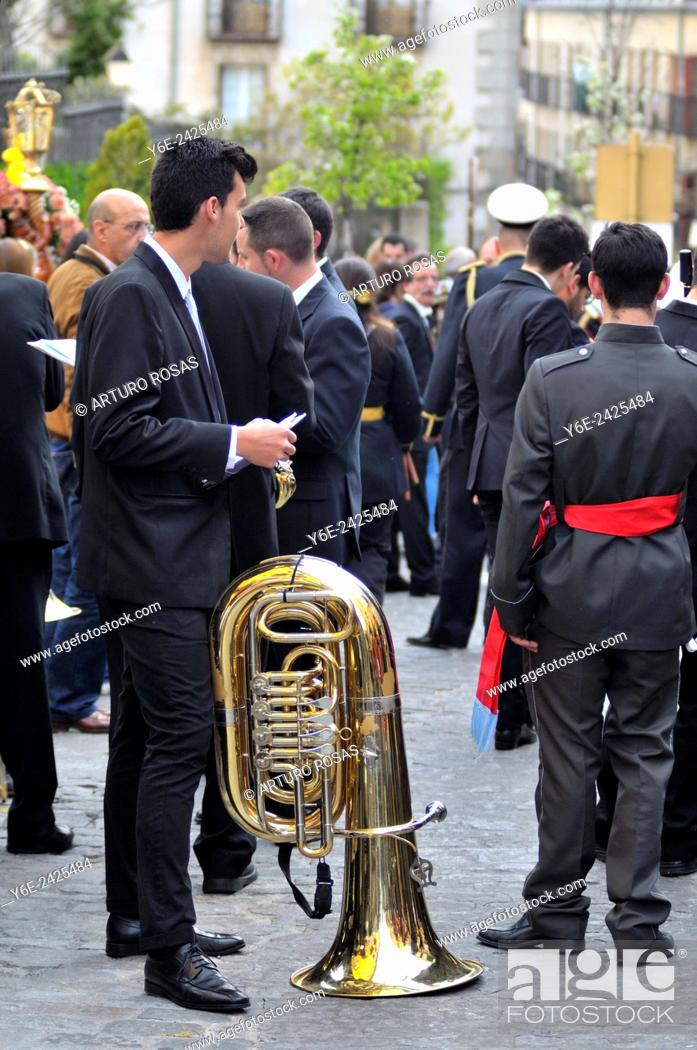 Stock Photo: A man with a tuba waiting for the start of the Easter Procession in San Lorenzo de El Escorial (Madrid), Spain.
