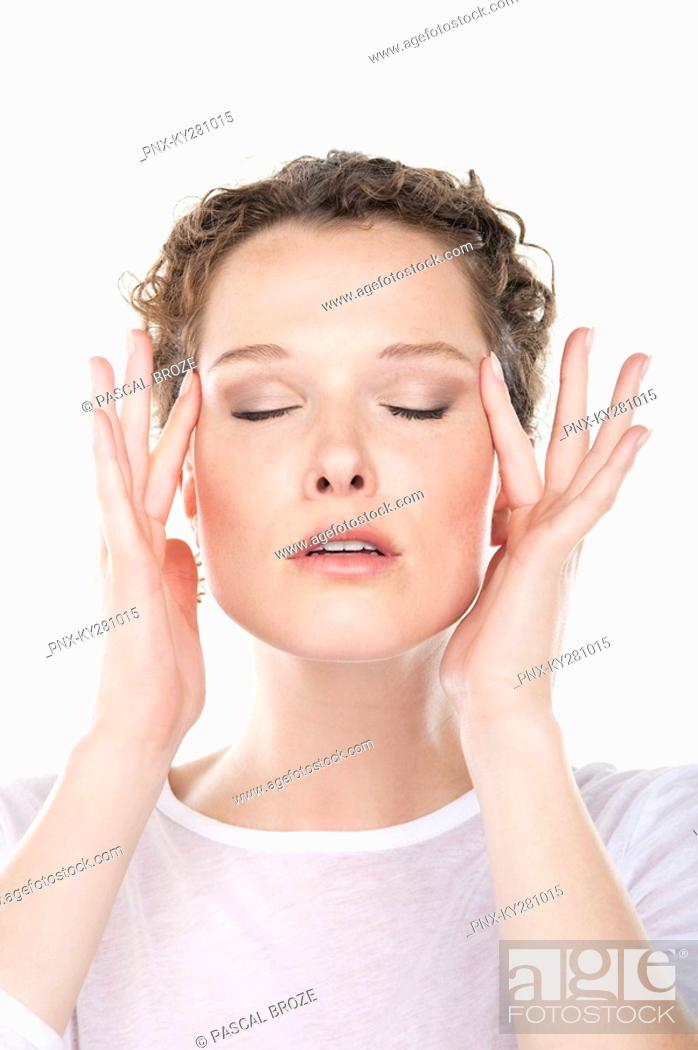 Stock Photo: Close-up of a woman rubbing temples.