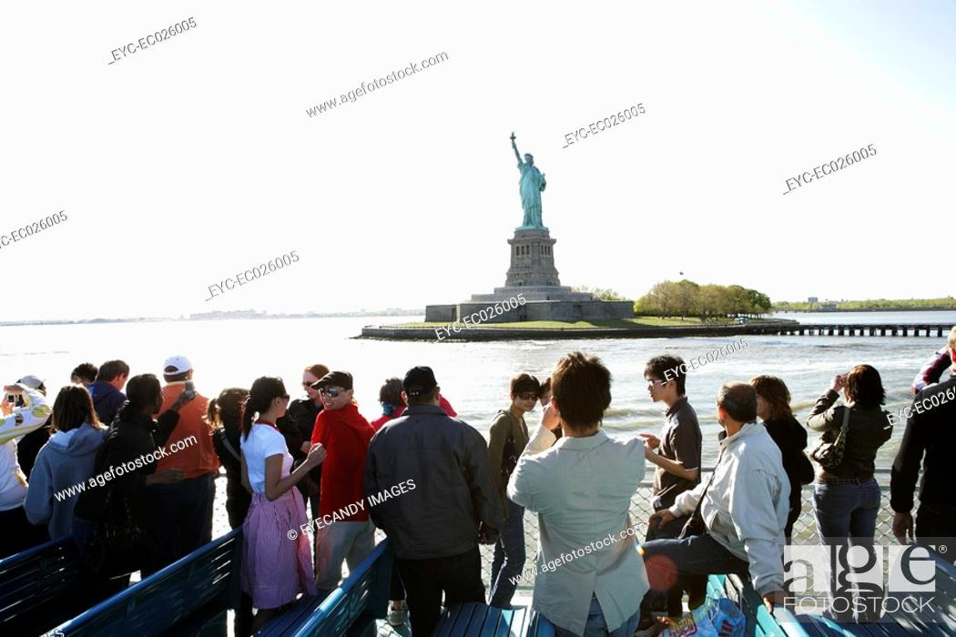 Stock Photo: Group of people on a ferry.