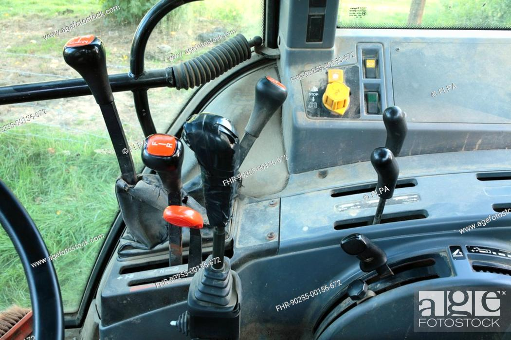 Interior of Ford 6640 tractor cab, main driver controls, gear levers ...