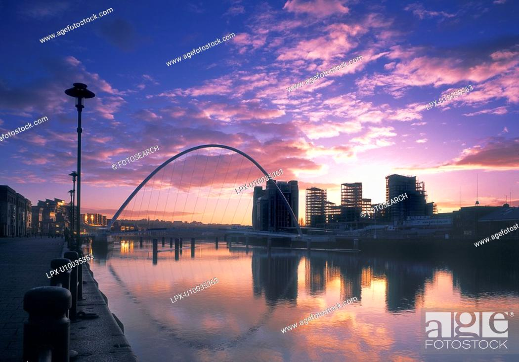 Stock Photo: Competed Millennium Bridge and waterfront.