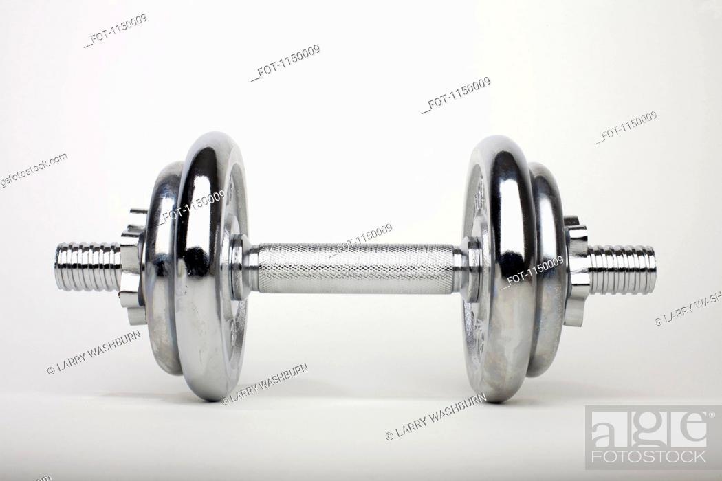 Stock Photo: A shiny silver dumbbell.
