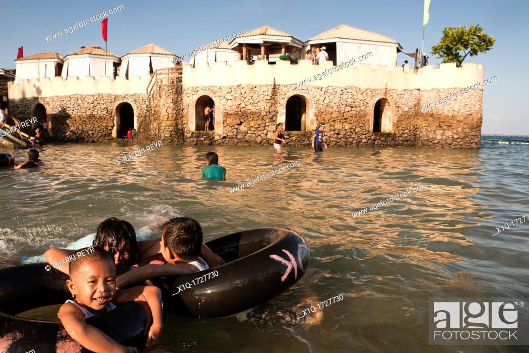 Stock Photo: Filipino children playing in the water at Blue Reef Mactan Island Resort  Lapu-Lapu City, Metro Cebu, Mactan Island, Visayas, Philippines.