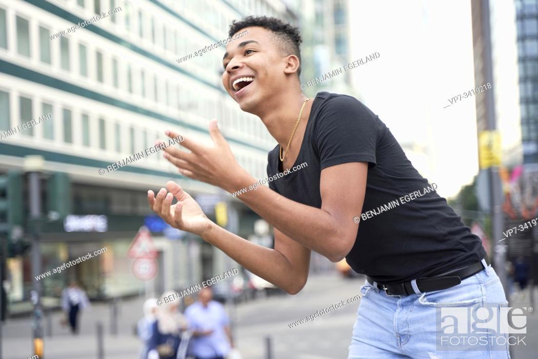 Stock Photo: Happy man on the street, Frankfurt am Main, Germany.