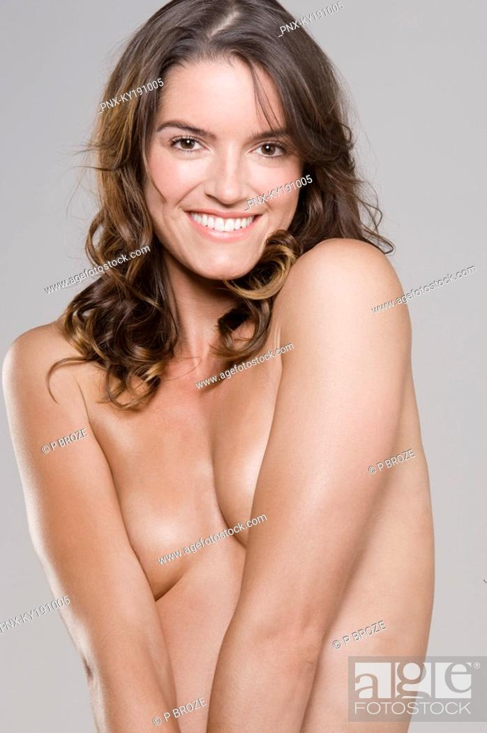 Stock Photo: Portrait of a naked woman smiling.