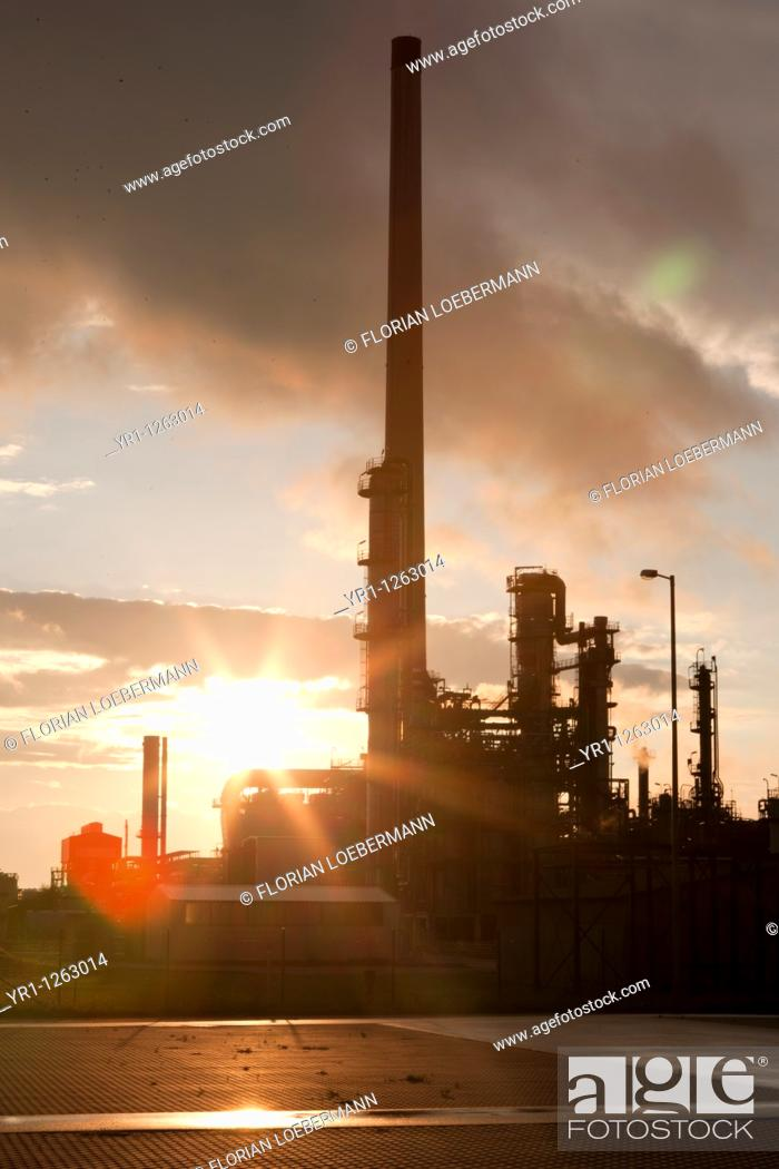 Stock Photo: Sunset over an oil refinery in germany.