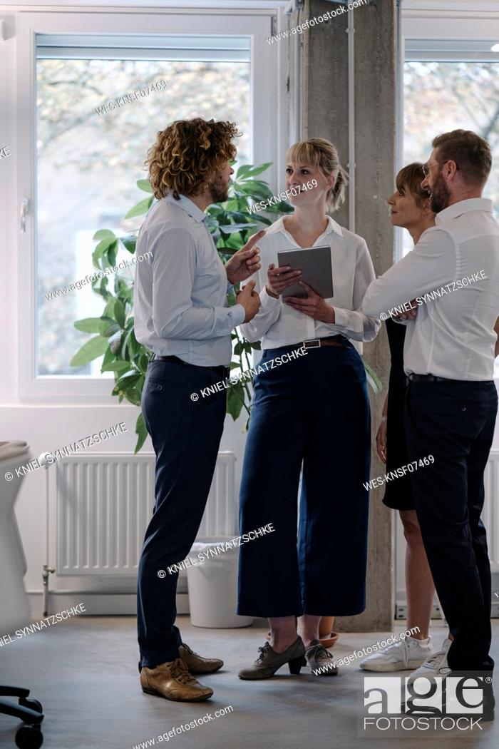 Stock Photo: Business team having a meeting in office.