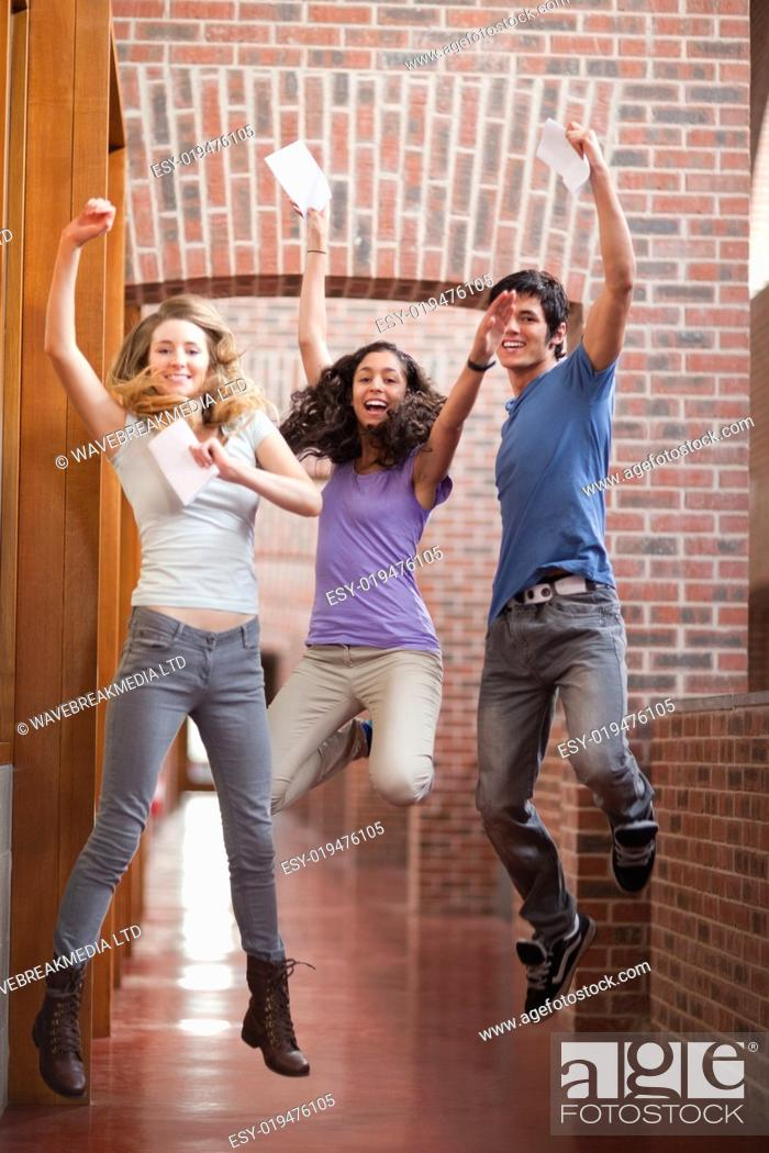 Imagen: Portrait of successful students jumping.