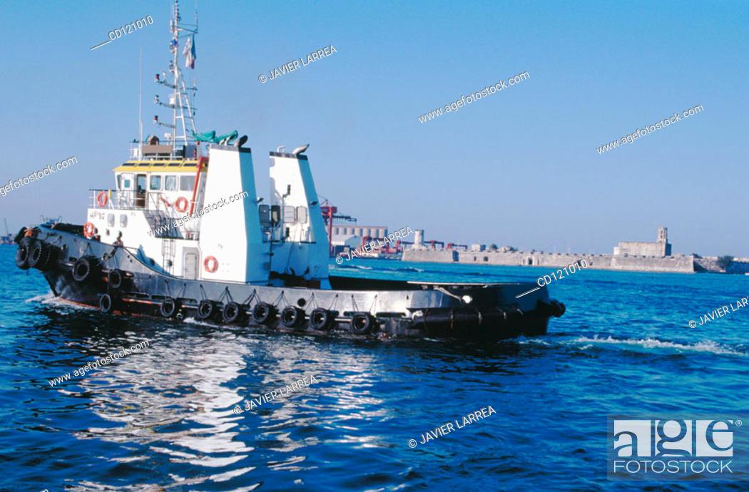 Stock Photo: Tugboat in front of San Juan de Ulua fort. Veracruz. Mexico.