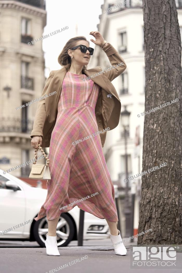 Stock Photo: fashionable blogger woman at street during fashion week, in city Paris, France.