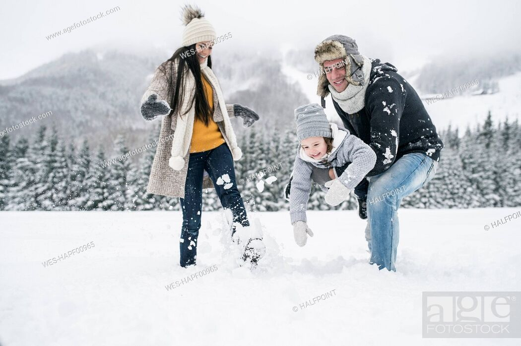 Stock Photo: Happy family in winter landscape.