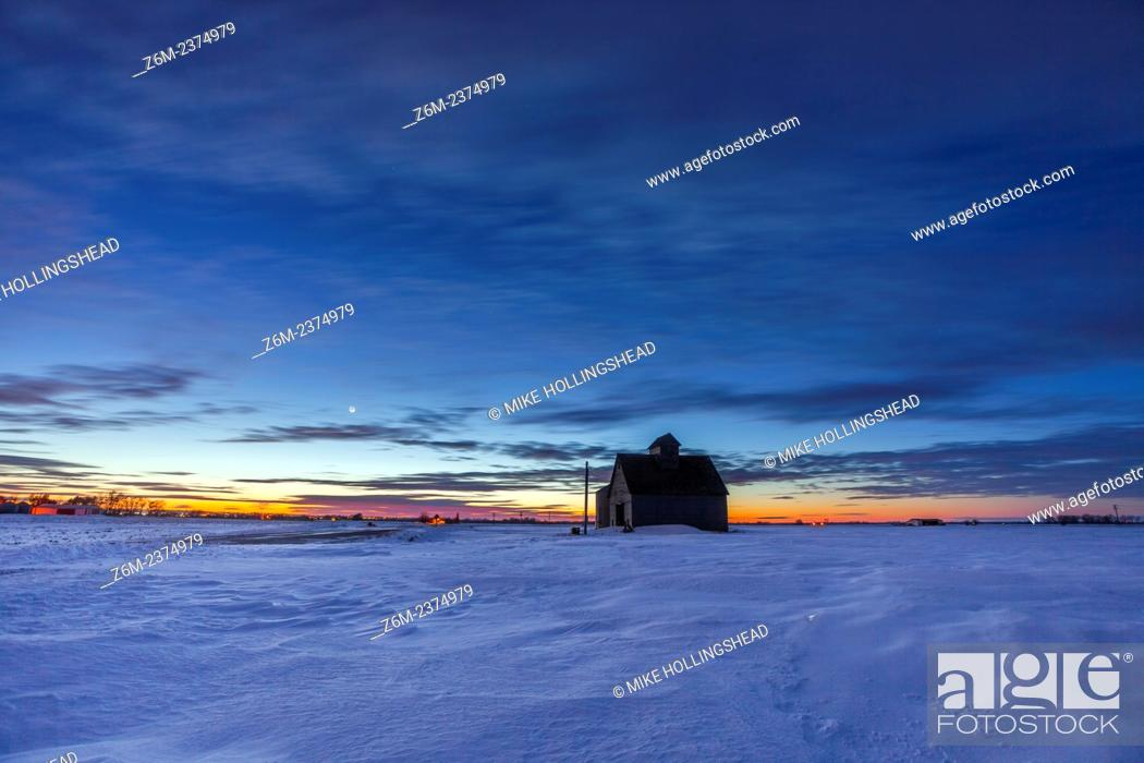 Stock Photo: Twilight fades over a barn and snowy western Iowa landscape.