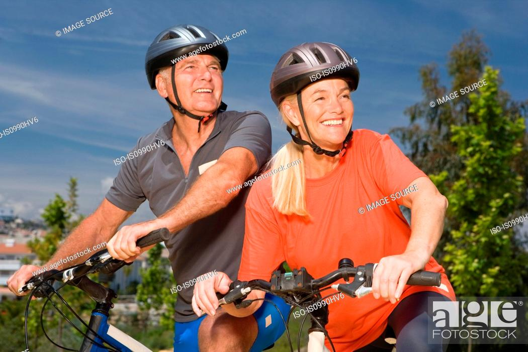 Stock Photo: Mature couple on bicycles.