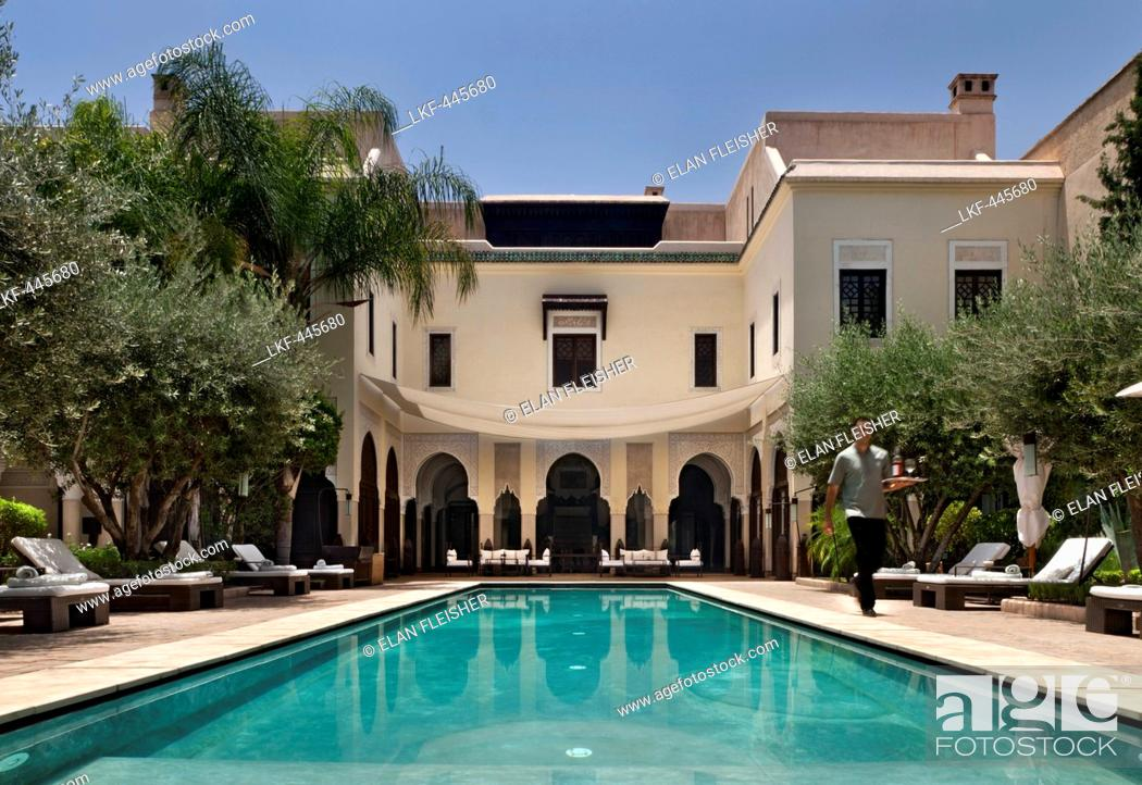 Stock Photo: Loungers around the pool, Villa des Orangers, Marrakech, Morocco.