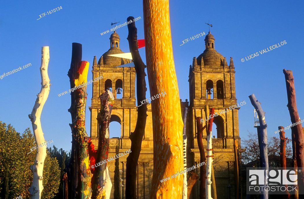 Stock Photo: `Bosque Encantado',enchanted Forest, by Agustín Ibarrola Goicoechea, in background Santísima Trinidad church,Salamanca,Spain.