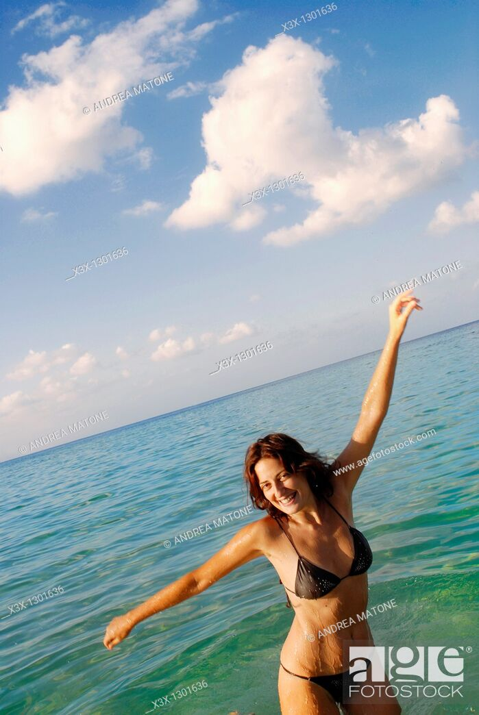 Stock Photo: Having fun in the waters of Sicily Italy.