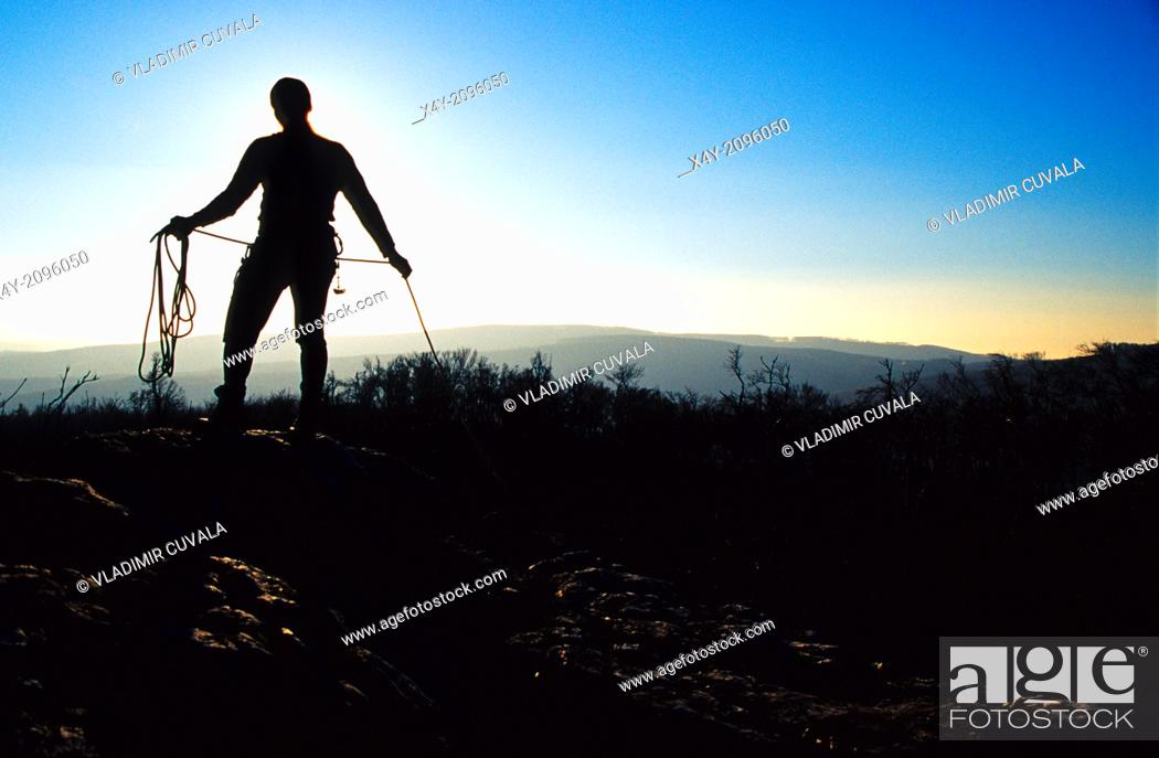 Stock Photo: The silhouette of a climber packing his rope, Male Karpaty, Slovakia.